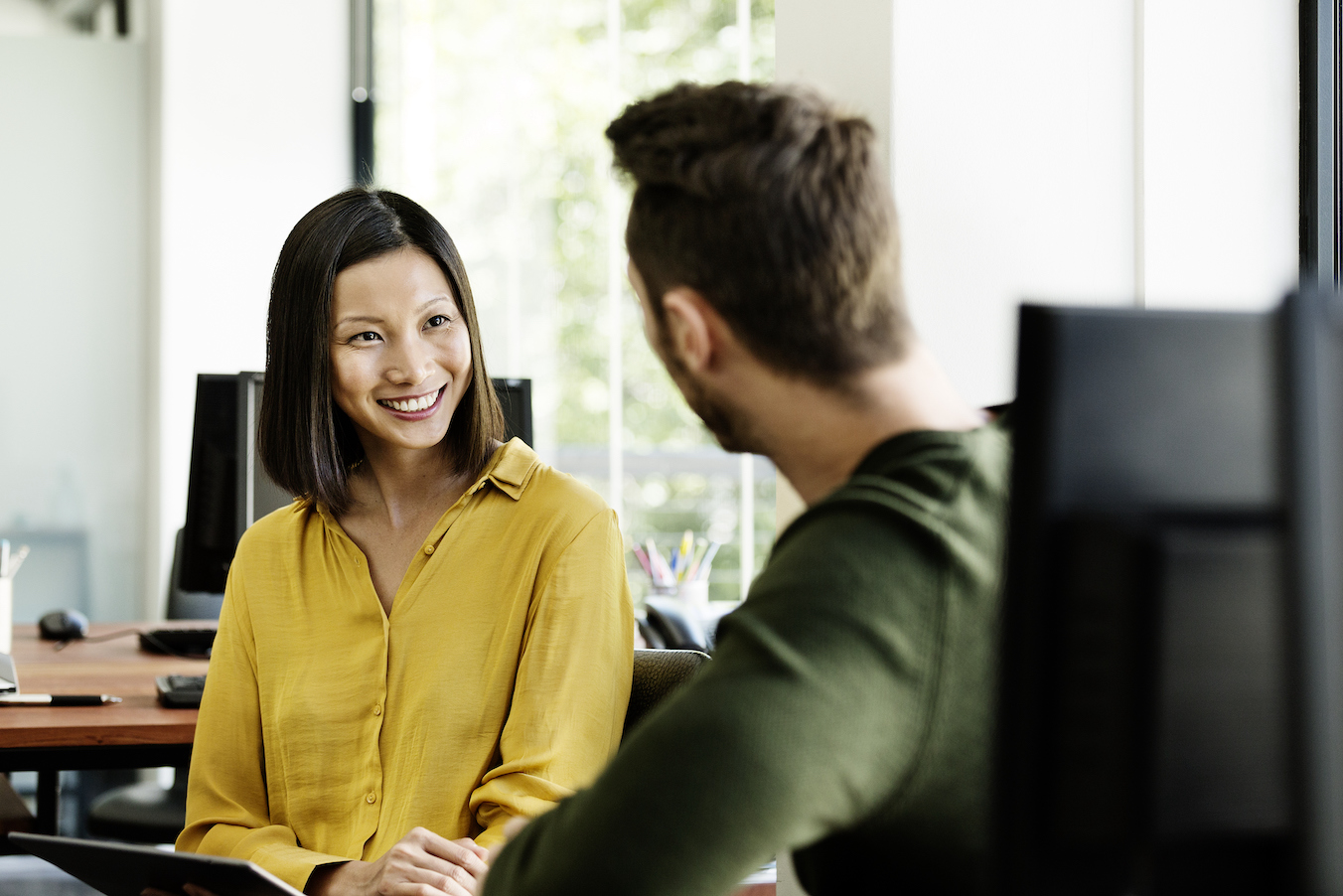 Peer support program at work with a Businesswoman discussing with colleague in office | Yes Psychology