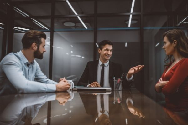 workplace mediation services at work with male manager having discussion with a male and female employees | Yes Psychology